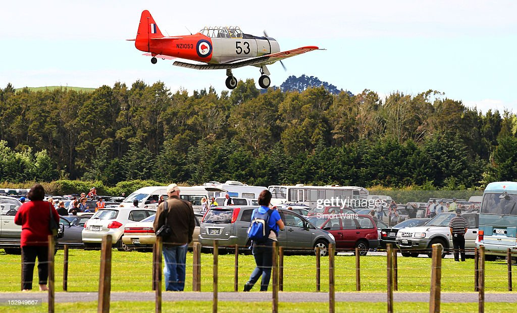 The Roaring 40's Harvard display team perform during an airshow commemorating the rebuild of de Havilland Mosquito KA 114, on September 29, 2012 in Ardmore, New Zealand. The plane was restored by Warbird Restorations at Ardmore Aerodrome and is the only flying Mosquito in the world.