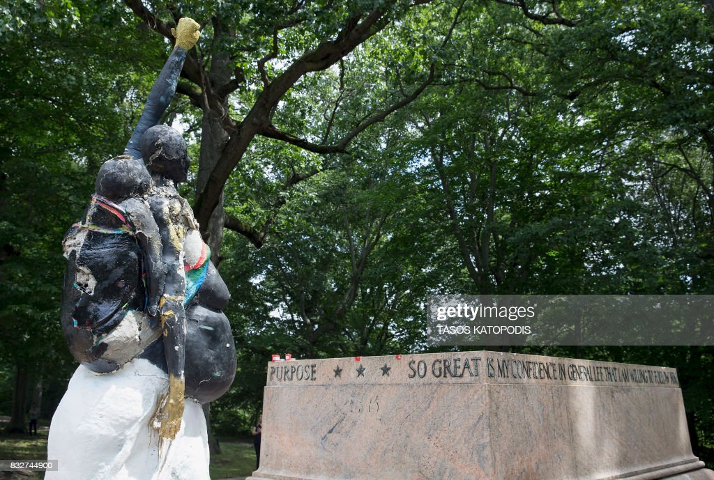 TOPSHOT - The Robert E. Lee and Thomas J. 'Stonewall' Jackson monument base is viewed in Wyman Park Dell in Baltimore, Maryland, after being removed by the city on August 16, 2017 . Confederate statues were removed overnight in Baltimore, Maryland, as a campaign to erase symbols of the pro-slavery Civil War South gathers momentum across the United States. The removal of the Baltimore monuments came four days after clashes in Charlottesville, Virginia that stemmed from a rally called by white supremacists to protest plans to remove a statue of Lee from a public park. KATOPODIS