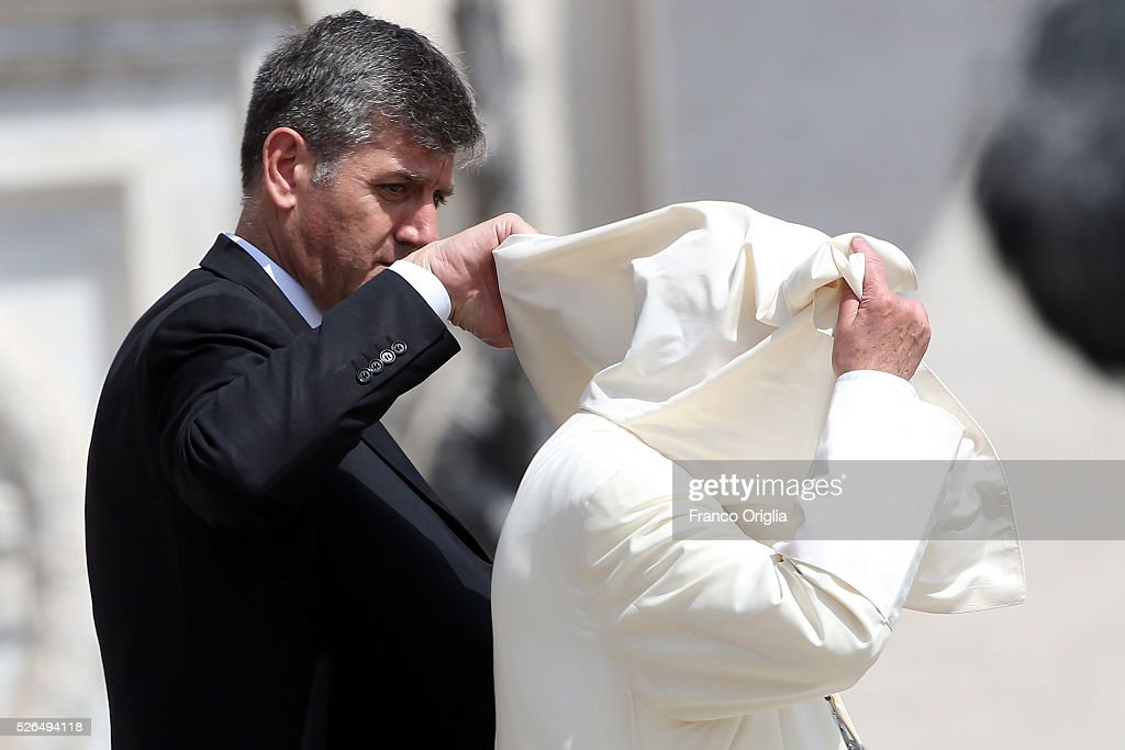 The robes of Pope Francis are blown over his head by a gust of wind as he holds a Jubilee Audience in St. Peter's Square on April 30, 2016 in Vatican City, Vatican. Pope Francis held an extraordinary Jubilee Audience in St. Peter's Square for thousands of eager pilgrims. The Audience also celebrated the Jubilee for members of the police and armed forces.