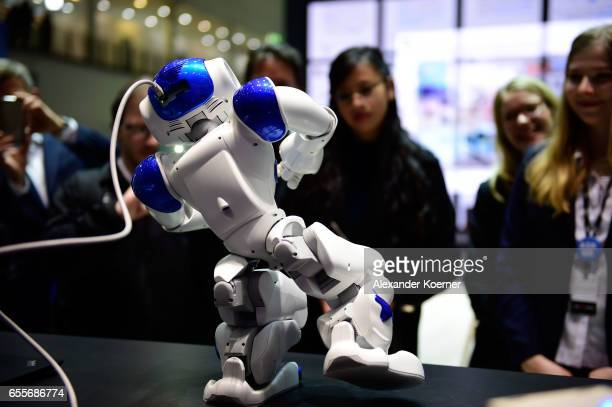 The robot 'Nao' performs Tai Chi at the IBM stand at the CeBIT 2017 Technology Trade Fair on March 20 2017 in Hanover Germany 'Nao' has a face...
