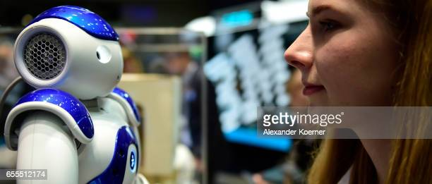 The robot 'Nao' speaks with a visitor of the CeBIT 2017 Technology Trade Fair on March 20 2017 in Hanover Germany 'Nao' has a face detection and can...