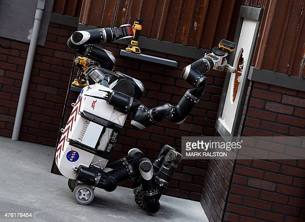The robot 'RoboSimian' developed by the NASA Jet Propulsion Laboratory completes a task during the finals of the DARPA Robotics Challenge at the...