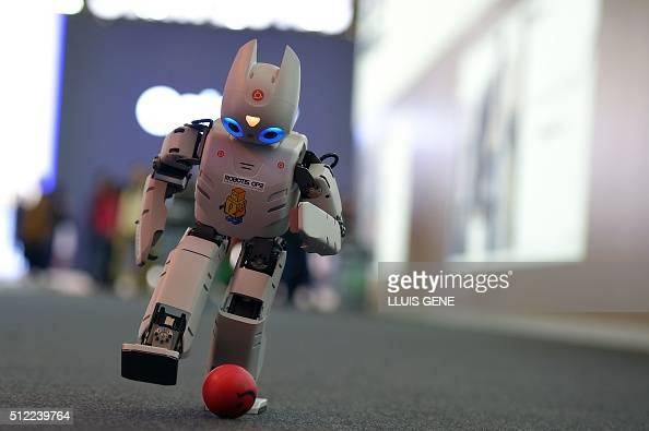 The robot 'Robotis OP2' kicks a ball on the last day of the Mobile World Congress in Barcelona on February 25 2016 The world's biggest mobile fair...