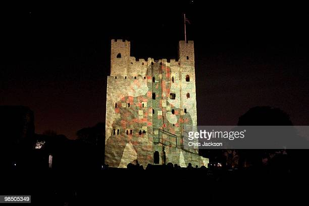 The Rochester Castle is illuminated by a 3D animation lightshow on April 16 2010 in Rochester England Images of rock band AC/DC and Iron Man 2 are...