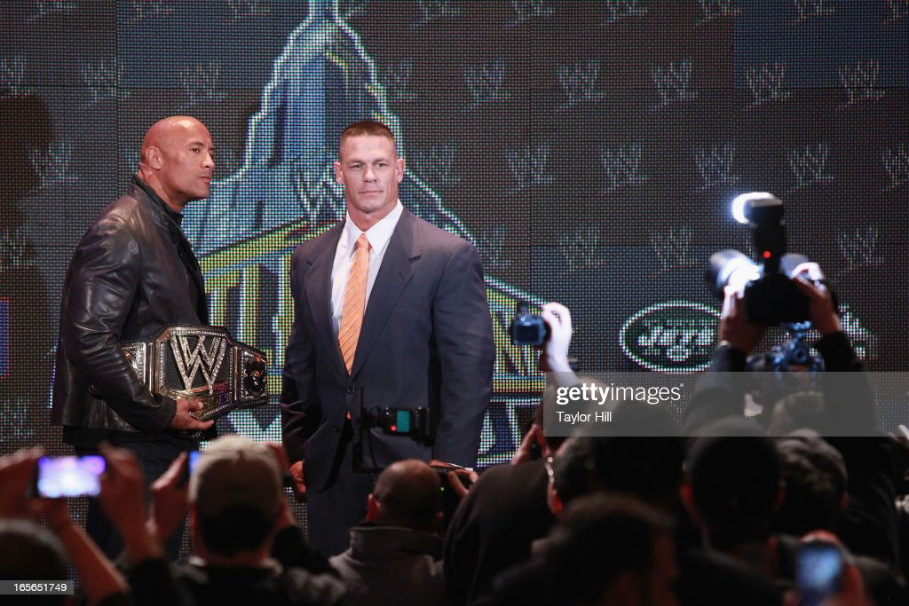 The Rock and <a gi-track='captionPersonalityLinkClicked' href=/galleries/search?phrase=John+Cena&family=editorial&specificpeople=644116 ng-click='$event.stopPropagation()'>John Cena</a> attend the WrestleMania 29 Press Conference at Radio City Music Hall on April 4, 2013 in New York City.