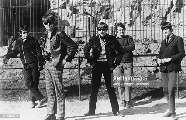 The rock group The Animals singer Eric Burdon bass guitarist Chas Chandler guitarist Hilton Valentine uknown and keyboardist Dave Rowberry