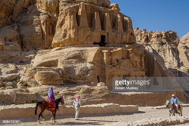 CONTENT] The rock hewn Nabatean Obelisk Tomb with the ancient Roman BabasSiq Triclinium below The road down to Petra A Bedouin leads his wife on a...