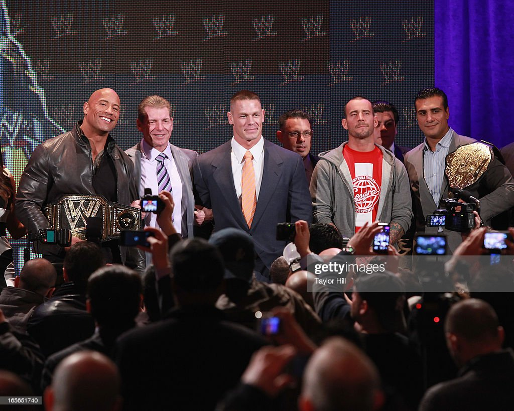 The Rock, <a gi-track='captionPersonalityLinkClicked' href=/galleries/search?phrase=Vince+McMahon&family=editorial&specificpeople=644259 ng-click='$event.stopPropagation()'>Vince McMahon</a>, <a gi-track='captionPersonalityLinkClicked' href=/galleries/search?phrase=John+Cena&family=editorial&specificpeople=644116 ng-click='$event.stopPropagation()'>John Cena</a>, <a gi-track='captionPersonalityLinkClicked' href=/galleries/search?phrase=CM+Punk&family=editorial&specificpeople=5386116 ng-click='$event.stopPropagation()'>CM Punk</a> attend the WrestleMania 29 Press Conference at Radio City Music Hall on April 4, 2013 in New York City.