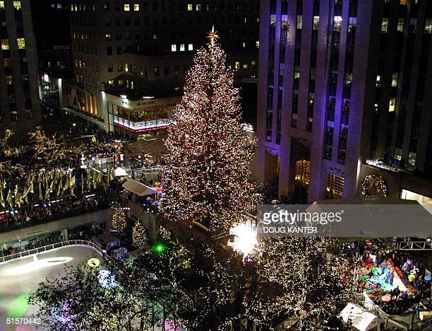 The Rockefeller Center Christmas tree is seen during the lighting ceremony in New York 29 November 2000 Thousands filled the streets to see the 30000...