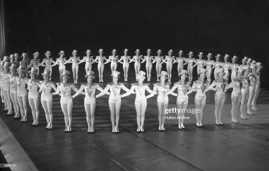 The Rockettes forming a circle on stage at Radio City Music Hall, Rockefeller Center, New York City.
