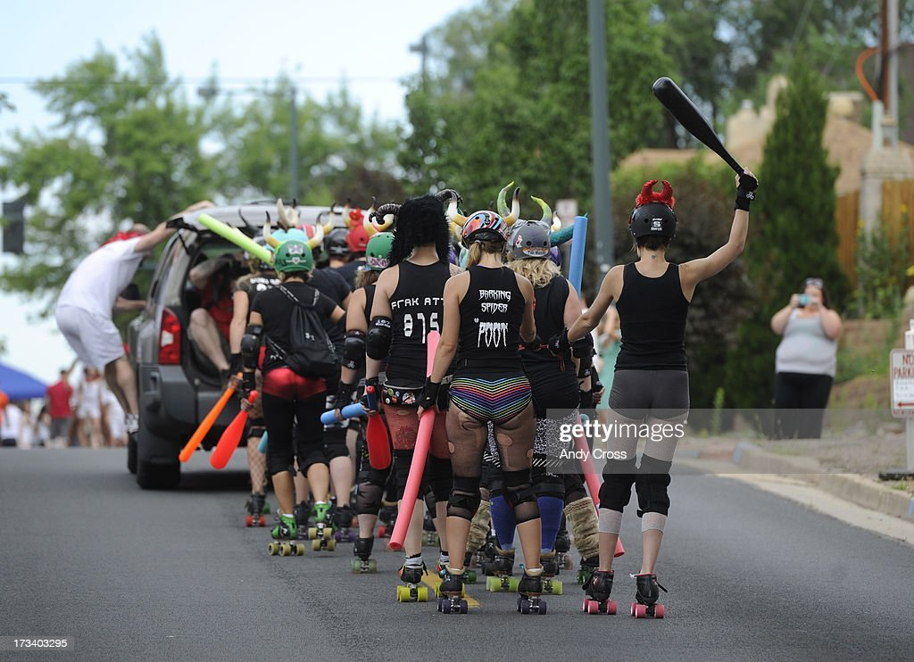 The Rocky Mountain Rollergirls arrive, via a tow, for the third annual Highland Running of the Bulls one-mile race in the Highland neighborhood in Denver Colorado Saturday morning, July 13, 2013. Inspired by the running of the bulls in Pamplona Spain, runners get chased through the course by the Rocky Mountain Rollergirls wielding foam and plastic bats, proceeds from the race benefit the Tennyson Center for Children whose aim is to work with children, youth, and their families to overcome a variety of life crises, including abuse and neglect.