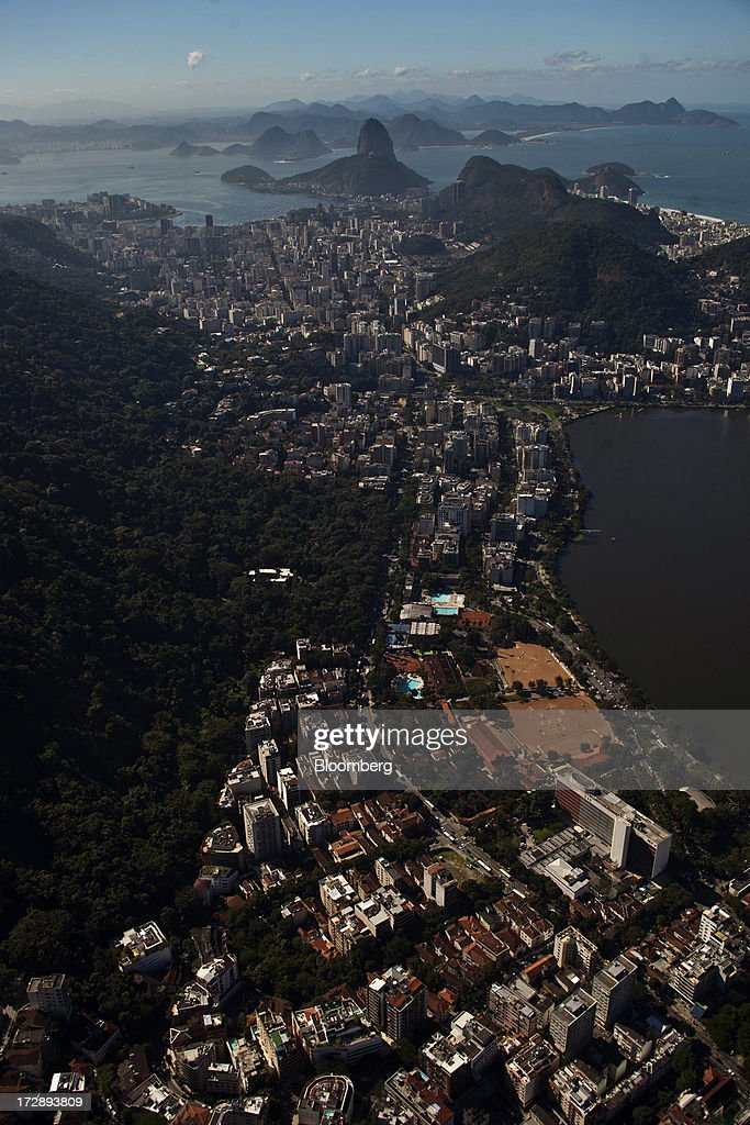 The Rodrigo de Freitas Lagoon is seen in this aerial photograph of Rio de Janeiro, Brazil, on Thursday, July 4, 2013. Brazils shorter-term swap rates fell after a report showed inflation slowed in June more than analysts forecast, damping speculation that the central bank will increase borrowing costs at a faster pace. Photographer: Dado Galdieri/Bloomberg via Getty Images