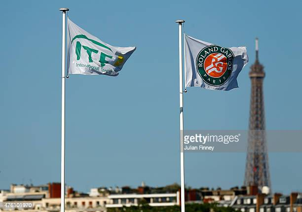 The Roland Garros flag flies over Court Philippe Chatrier with The Eiffel tower seen in the background during the Women's Singles Final on day...