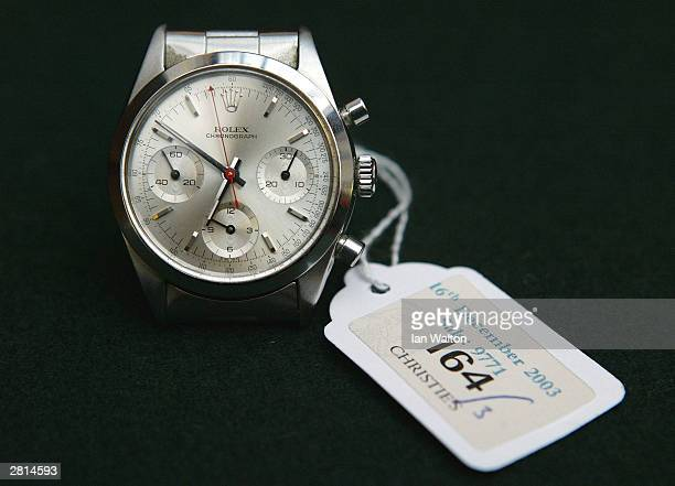 The Rolex wristwatch worn by George Lazenby during the film 'On Her Majesty's Secret Service' is seen on display at an auction at Christie's auction...