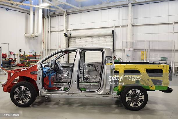 The rolling chassis of a Honda Motor Co 2017 Ridgeline pickup truck sits inside of the safety operations area of the Honda Auto Plant in Marysville...