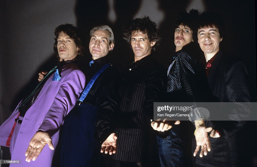 The Rolling Stones are photographed at a portrait shoot in the 1980's in New York City.