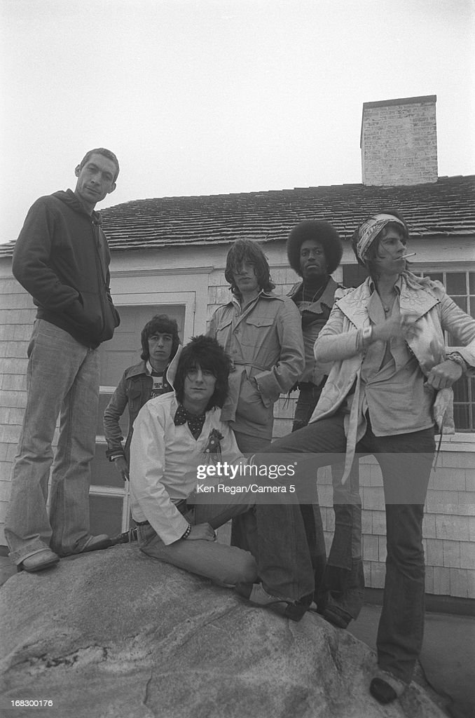 Charlie Watts, Bill Wyman, Ronnie Wood, Mick Jagger and Keith Richards) are photographed with a session musician at artist Andy Warhol's home in 1975 in Montauk, New York.