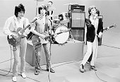 The Rolling Stones during rehearsal New York 1978 L R Ronnie Wood Keith Richards Charlie Watts Mick Jagger and hidden behind Mick Bill Wyman