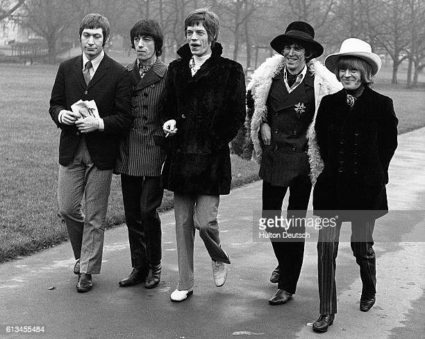 The Rolling Stones go for a walk through Green Park in London They are Charlie Watts Bill Wyman Mick Jagger Keith Richards and Brian Jones