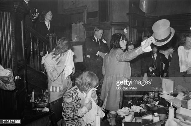 The Rolling Stones in a custard pie fight at the Kensington Gore Hotel where they staged a mockmedieval banquet for the launch of their new album...