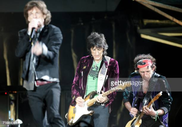 The Rolling Stones members Mick Jagger Ron Wood and Keith Richards perform on stage at Twickenham Stadium August 2006 in London England