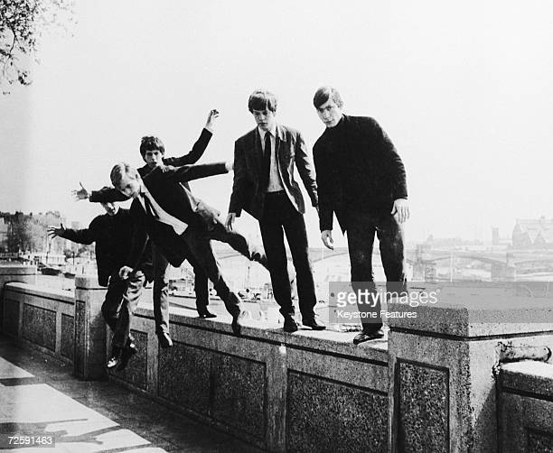 The Rolling Stones messing about on a wall at Embankment London circa 1963