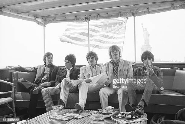 The Rolling Stones relax aboard a yacht while cruising along New York Harbor Charlie Watts Keith Richards Mick Jagger Brian Jones and Bill Wyman are...