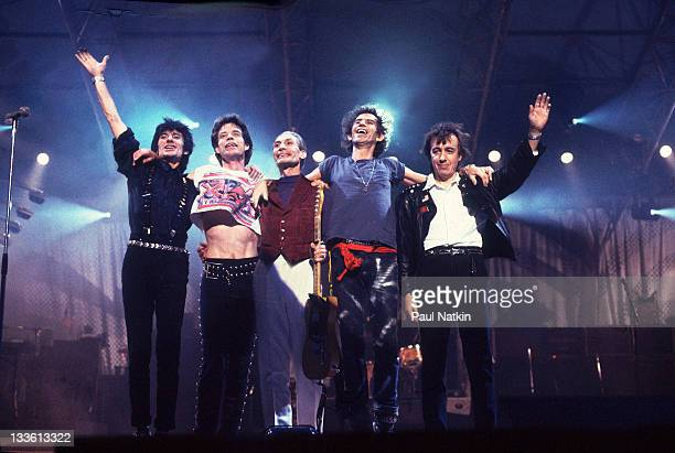 The Rolling Stones wave from the stage following a performance during their 'Steel Wheels' tour late 1989 Pictured are from left Ron Wood Mick Jagger...