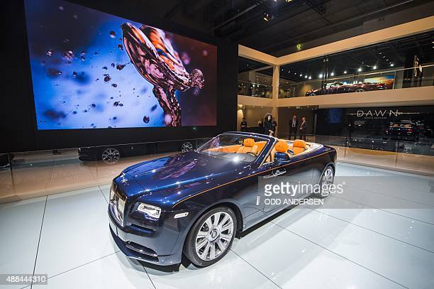The RollsRoyce Dawn convertible is presented at the booth of the British carmaker during a press day of the 66th IAA auto show in Frankfurt am Main...