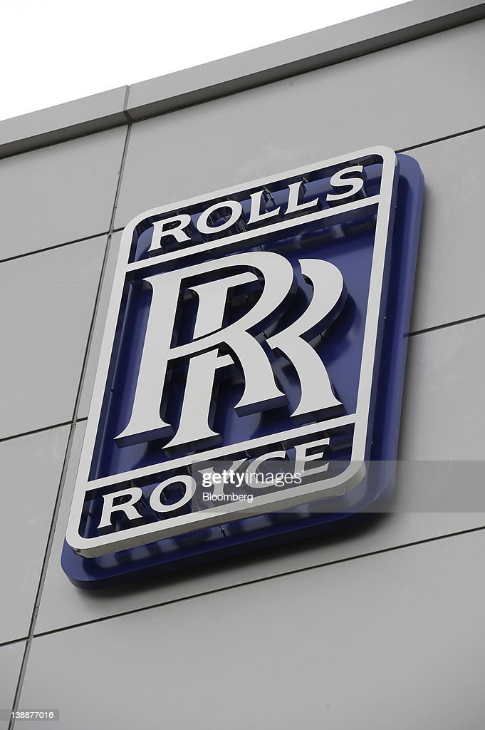 The Rolls-Royce Holdings Plc logo is displayed on the company's new facility in Singapore, on Monday, Feb. 13, 2012. Rolls-Royce plans to build 250 Trent engines a year in Singapore and raise the workforce in the city to 2,000. Photographer: Munshi Ahmed/Bloomberg via Getty Images