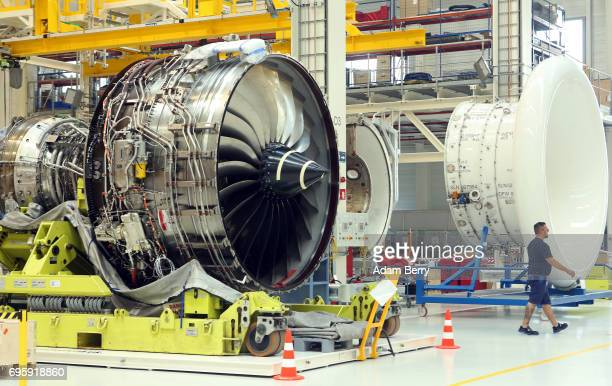 The RollsRoyce Trent XWB airplane engine to be used in the Airbus A350 XWB aircraft and its casing are seen on the engine's assembly line as an...