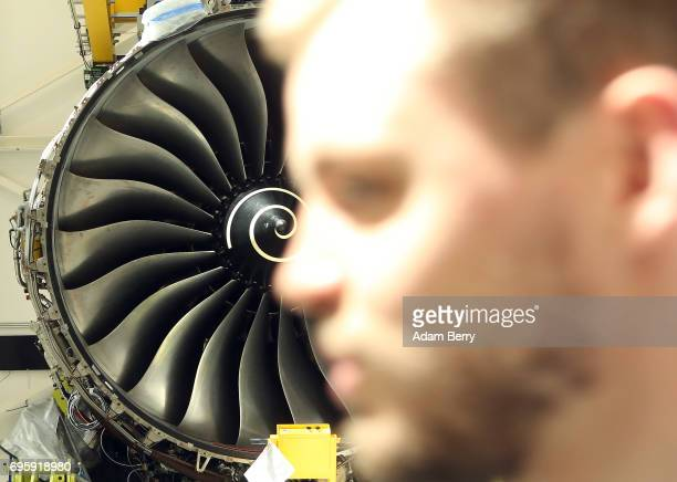 The RollsRoyce Trent XWB airplane engine to be used in the Airbus A350 XWB aircraft is seen on its assembly line as an employee passes on June 14...