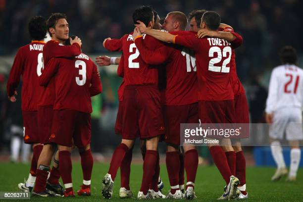 The Roma players celebrate the 21 victory at the final whistle during the Serie A match between Roma and AC Milan at the Olympic Stadium on March 15...
