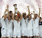 The Roma team celebrate winning the Coppa Italia after the Coppa Italia final second leg match between Internazionale and Roma at the Stadio Giuseppe...