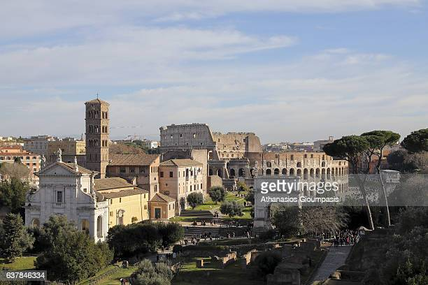 The Roman Forum and The Colosseum on December 31 2016 in Rome Italy The Roman Forum is a rectangular forum surrounded by the ruins of several...