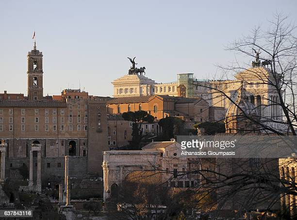 The Roman Forum at the sunset on December 30 2016 in Rome Italy The Roman Forum is a rectangular forum surrounded by the ruins of several important...