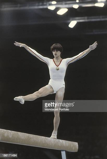 The romanian gymnast Nadia Comaneci performing an exercise during a race in the Moscow Olympic games Moscow Russian Federation 1980