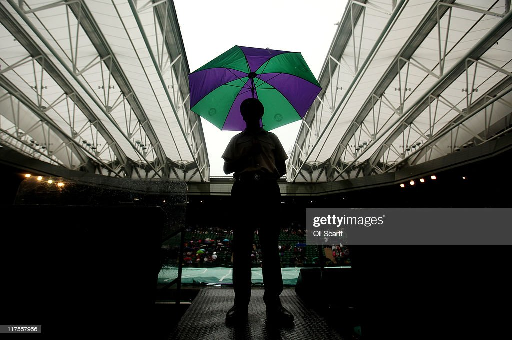 The roof closes on centre court as rain delays play on Day Eight of the Wimbledon Lawn Tennis Championships at the All England Lawn Tennis and Croquet Club on June 28, 2011 in London, England.