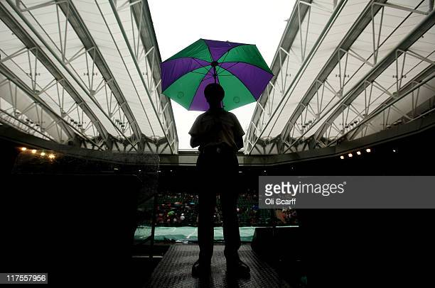 The roof closes on centre court as rain delays play on Day Eight of the Wimbledon Lawn Tennis Championships at the All England Lawn Tennis and...