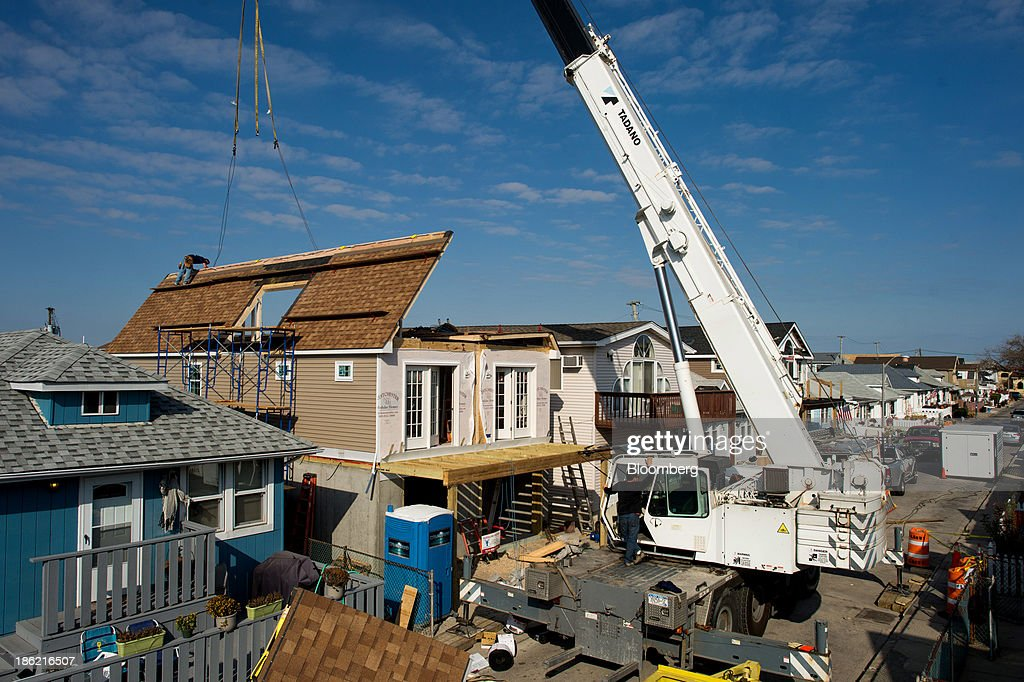 The Roof For Half Of A Westchester Modular Homes Unit Is Lifted Into Place  During Assembly