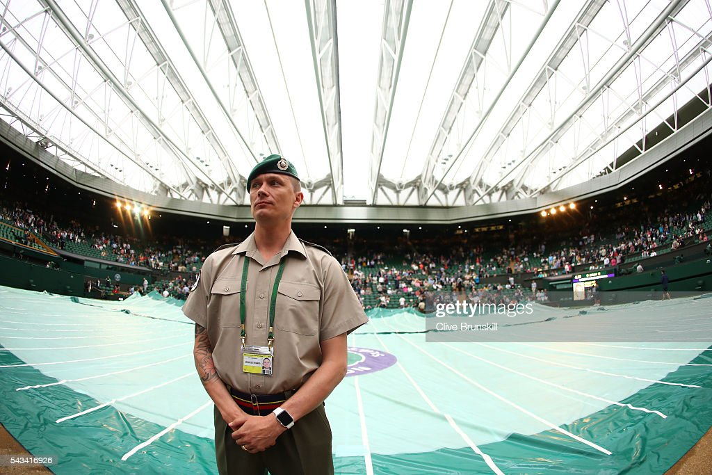 The roof is closed and the court is covered due to rain, on centre court on day two of the Wimbledon Lawn Tennis Championships at the All England Lawn Tennis and Croquet Club on June 28, 2016 in London, England.