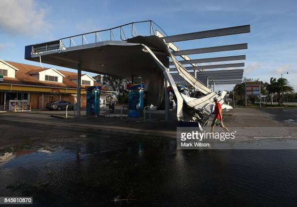 The roof of a gas station is shown damaged by Hurricane Irma winds on September 11 2017 in Bonita Springs Florida Yesterday Hurricane Irma hit...
