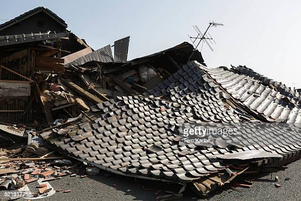 The roof of a house is left collapsed after an earthquake on April 15 2016 in Mashiki town Kumamoto Japan At least nine people have died in a...