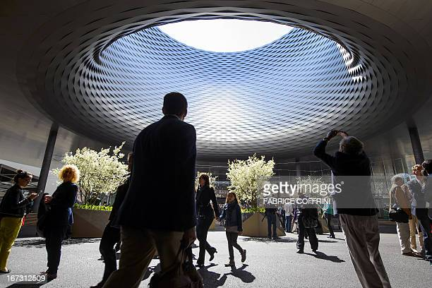 The roof of the new exhibition halls designed by Basel architects Herzog de Meuron attract interest during the press day ahead of fair Baselworld on...