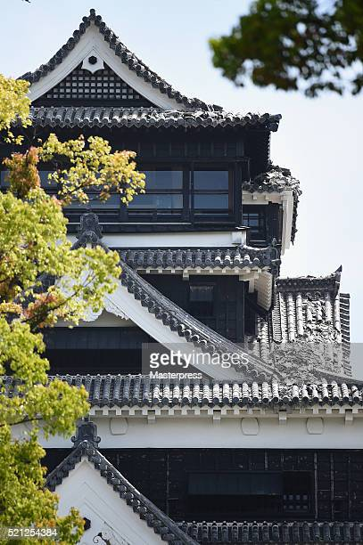 The roof tiles of Kumamoto Castle are seen damaged by the earthquake on April 15 2016 in Kumamoto Japan Kumamoto Castle is a major tourism...