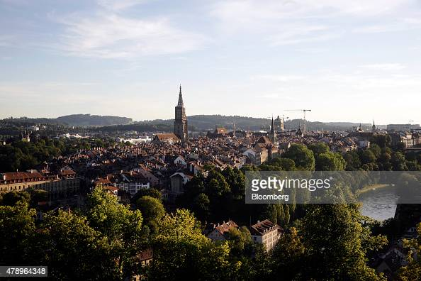 The rooftops of buildings and Church spires are seen on the skyline overlooking Bern Switzerland on Sunday June 28 2015 Swiss National Bank President...