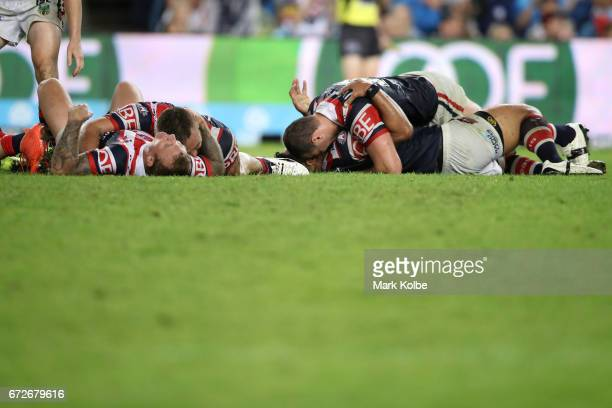 The Rooster celebrate victory after Mitchell Pearce of the Roosters kicked a field goal to claim golden point victory during the round eight NRL...