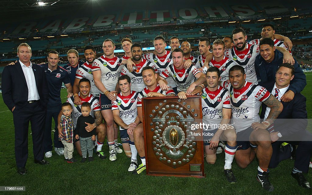 The Roosters team pose with the J.J. Giltinan Shield for winning the minor premiership during the round 26 NRL match between the South Sydney Rabbitohs and the Sydney Roosters at ANZ Stadium on September 6, 2013 in Sydney, Australia.