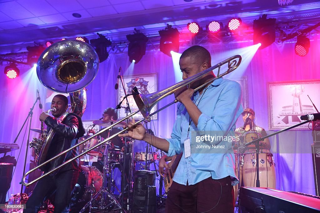 <a gi-track='captionPersonalityLinkClicked' href=/galleries/search?phrase=The+Roots+-+Band&family=editorial&specificpeople=234784 ng-click='$event.stopPropagation()'>The Roots</a> and Troy 'Trombone Shorty' Andrews perform at The Pepsi 5th Quarter on February 3, 2013 in New Orleans, Louisiana.