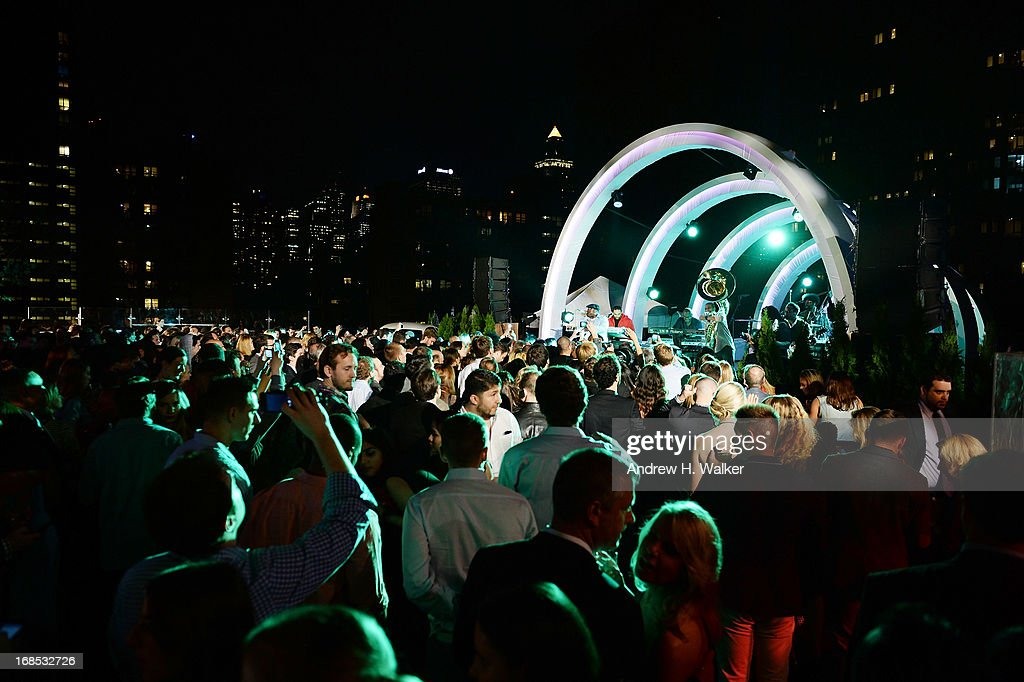 The Roots perform at the grand opening of the Audi and Volkswagen Manhattan dealership on May 10, 2013 in New York City.